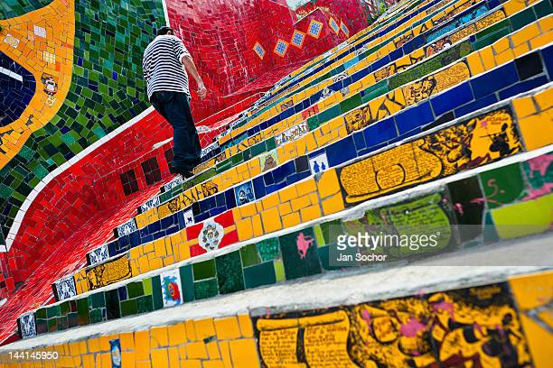 A man climbs the Selaron's Stairs a mosaic staircase made of colorful tiles on February 12 2012 in Rio de Janeiro Brazil World famous staircase...