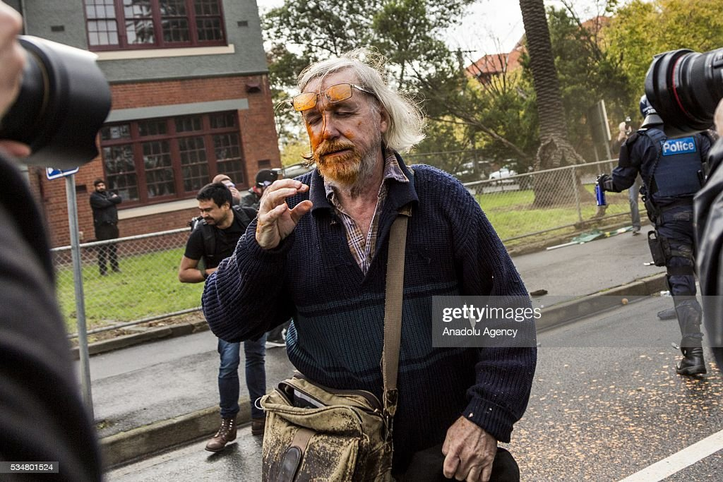A man closes his eye in pain after being pepper sprayed during a 'Say No To Racism' protest and a counter 'Stop the Far Left' rally in Coburg Melbourne, Australia May 28 2016. Seven men were arrested after a violent brawl erupted between rival protesters at an anti-racism rally in Melbourne's inner-north. Anti-Facists clashed with Anti-Islam nationalists whom go by the name 'True Blue Crew'.
