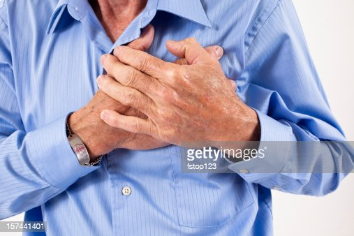 Man clutching his chest. in pain, possible heart attack