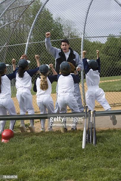 Man coaching motivating little league team