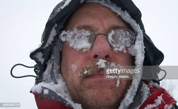 A man coated in snow after clearing snow in Hatboro Pennsylvania in the aftermath of snowstorm Juno
