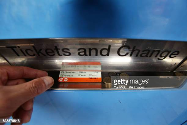 A man collecting train tickets from a machine at Finsbury Park station in north London as rail passengers will today learn just how much their season...