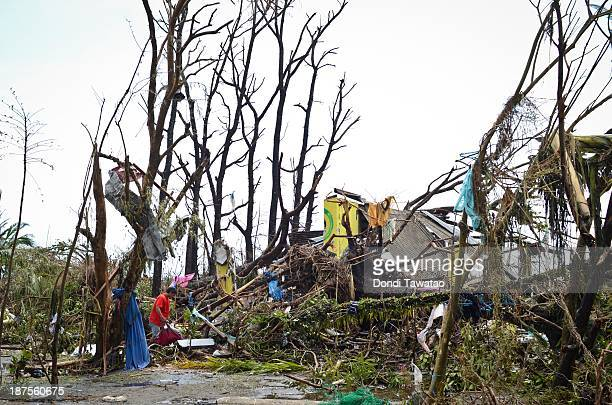 A man collects debris of what is left of his house in the aftermath of typhoon Haiyan on November 10 2013 in Tacloban City Leyte Philippines Typhoon...
