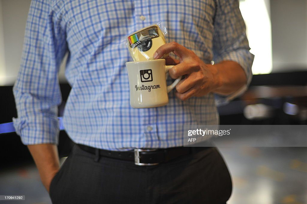 A man collects Instagram giveaways at Facebook's corporate headquarters during a media event in Menlo Park, California on June 20, 2013, where Facebook announced the introduction of video for Instagram. AFP Photo /Josh EDELSON