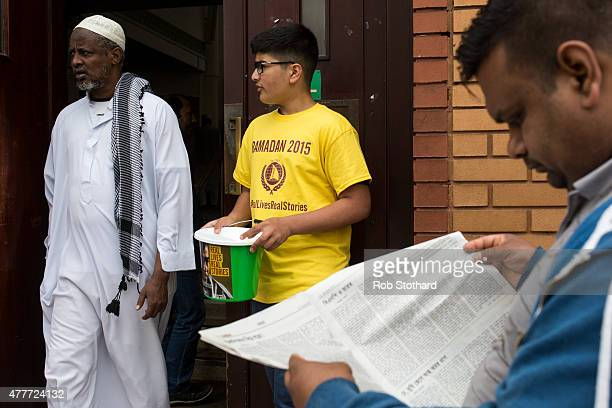 A man collects money for charity as people arrive at the East London Mosque to attend the first Friday prayers of the Islamic holy month of Ramadan...