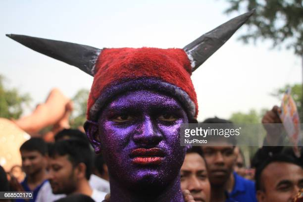 A man coloured his face joined in a rally to celebrate Bengali New Year 1424 in Dhaka Bangladesh on April 14 2017 People across the country are...