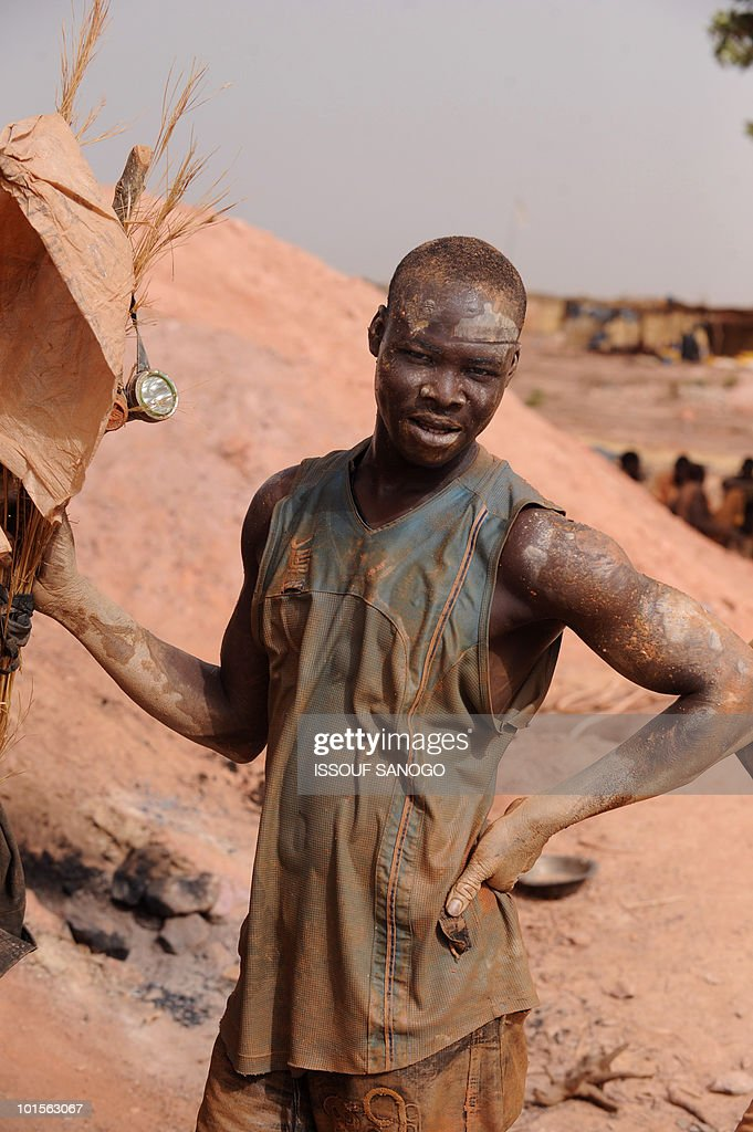 RETRAITE** A man comes out of a hole where he was digging for gold, in Namisgma,the largest gold washing site in the country, some 200 kilometers from Ouagadougou, Northern Burkina Faso on May 9, 2010. Gold in Burkina was until recently largely mined by hand despite the arrival of large gold companies.