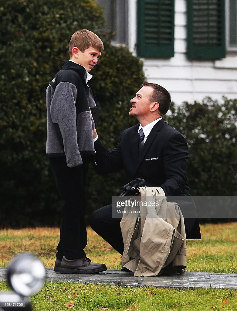 A man comforts a boy outside Honan Funeral Home before the funeral for 6-year-old Jack Pinto on December 17, 2012 in Newtown Connecticut. Pinto was one of the 20 students killed in the Sandy Hook Elementary School mass shooting.