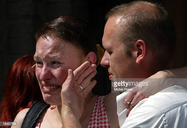 A man comforts a woman after paying their respects to slain politician Pim Fortuyn May 9 2002 at a Cathedral in Rotterdam Netherlands Thousands of...