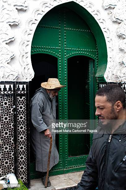 Man coming out of a mosque in the white medina