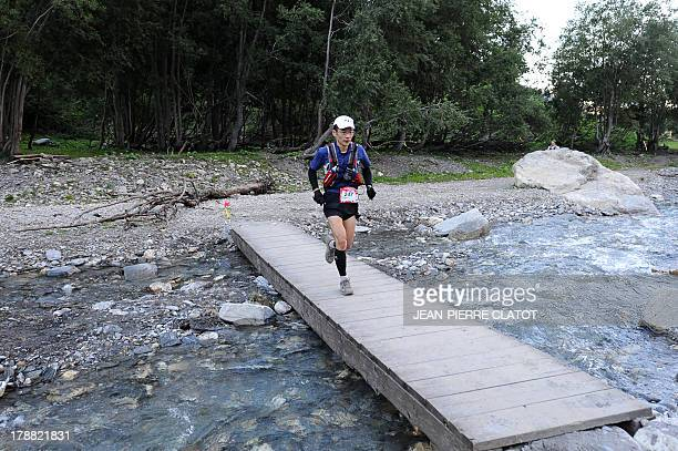 A man competes at the Italy's Col Ferret during the Ultra Trial race the 11th edition the Ultra Trial race a 168 km race around the Mont Blanc...