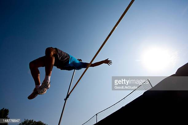 Man competing in high jump