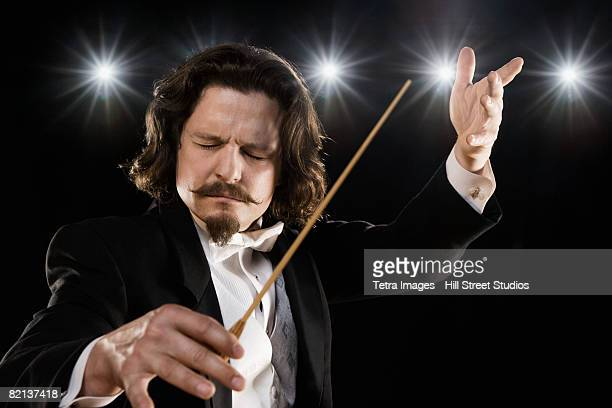 Man conducting under lights