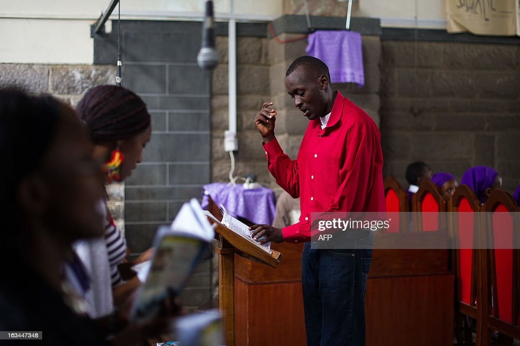 A man conducts a choir at St. Theresa's church in the Eastleigh neighbourhood of Nairobi, Kenya, on March 10, 2013. Kenyans called Sunday for reconciliation between the winning and losing camps in the presidential poll, a day after Uhuru Kenyatta, who faces an international trial for crimes against humanity, was declared the winner but his chief rival refused to concede.