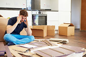 Frustrated Man Giving Up On Putting Together Self Assembly Furniture
