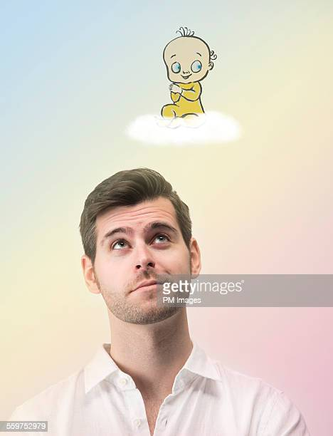 Man contemplating baby