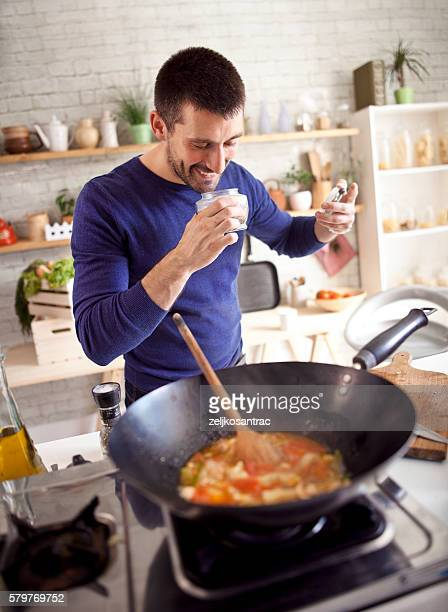 Man cooking and smelling spices
