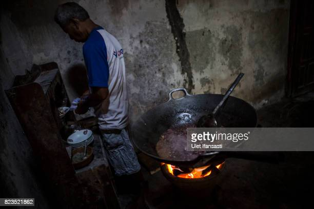 A man cooking dog meat at restaurant specialising in dog meat on July 27 2017 in Yogyakarta Indonesia Indonesians have seen a surprising hike in dog...