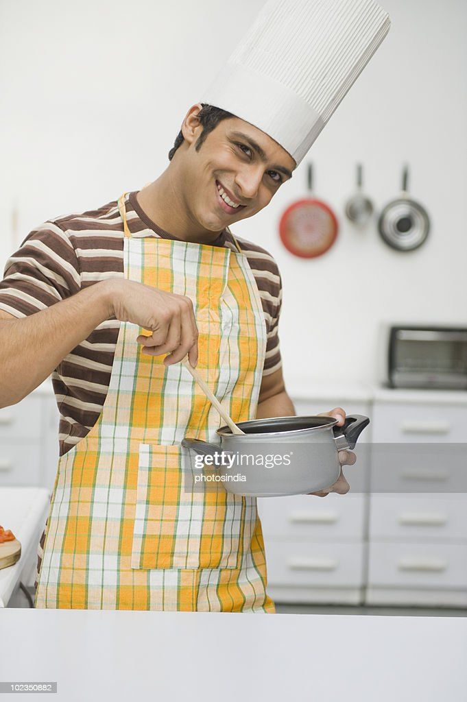 Man cooking in the kitchen : Stock Photo
