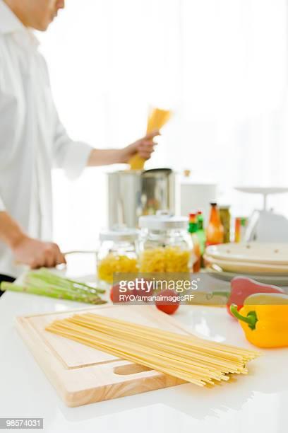 Man cooking pasta