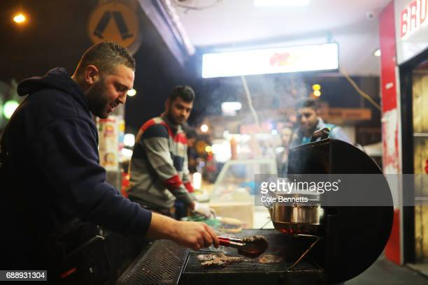 A man cooks a BBQ during a street festival in the southwestern suburb of Lakemba on May 27 2017 in Sydney Australia Muslims around the world mark the...