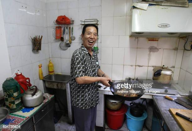 A man cooks in his Hutong near Hou Hai lake in Old Beijing China