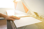 Man copying paper from Photocopier sunlight from windowMan copying paper from Photocopier sunlight from window