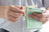man counting euro