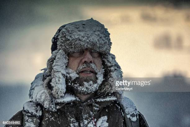 Man covered by snow in heavy snowstorm