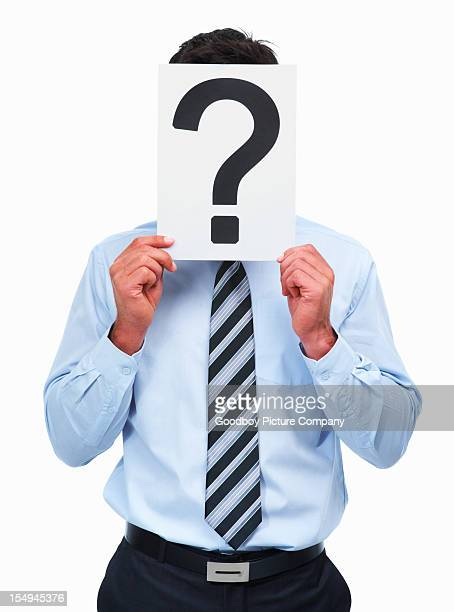 Man covering his face with a question mark sign