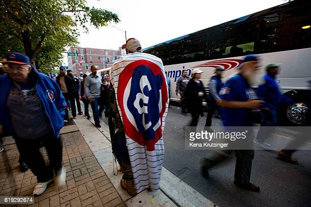 A man covers himself in a Cubs banner prior to Game Three of the 2016 World Series between the Chicago Cubs and the Cleveland Indians at Wrigley...