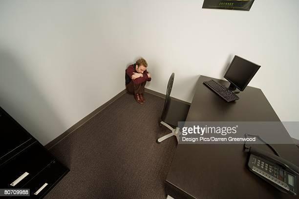 Man cowering in the corner