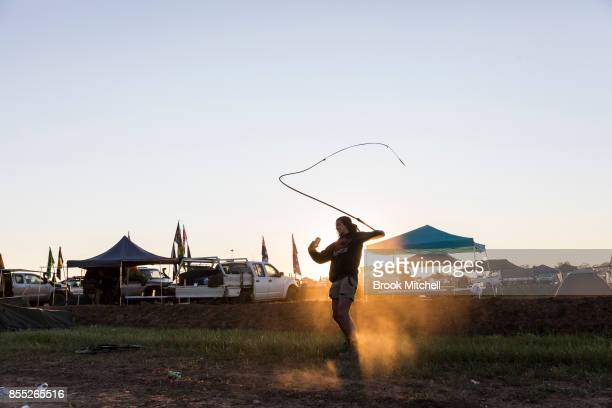 A man cracks a whip at dawn on day one of the 2017 Deni Ute Muster on September 29 2017 in Deniliquin Australia The annual Deniliquin Ute Muster is...