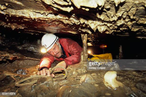 Man Crawling in Cave