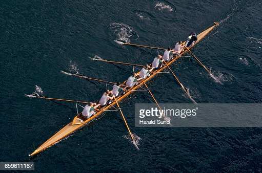 8 man crew competitive rowing race.