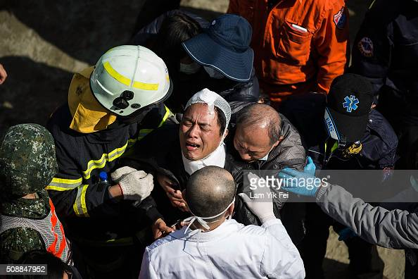 A man cries after his mother confirmed died near a collapsed building on February 7 2016 in Tainan Taiwan A magnitude 64 earthquake hit southern...