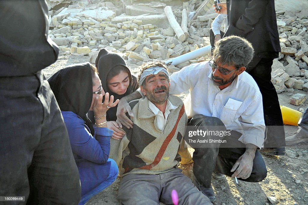 A man cries after the earthquakes on August 12, 2012 in Varzaqan, Iran. The two earthquake, within 11 minutes, jolted northwestern Iran on August 11, killed at least 300 people.
