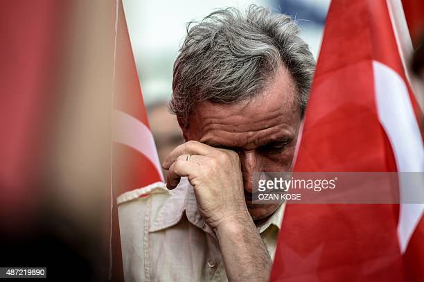 A man cries as he holds a Turkish flag during a demostration against the Kurdish Worker Party on September 7 2015 in Istanbul The Turkish army today...