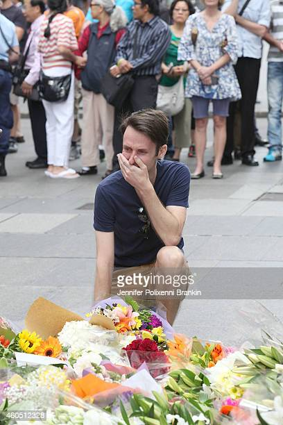 A man cries as he pays his respect at Martin Place on December 16 2014 in Sydney Australia Three people have been confirmed killed when a gunman took...