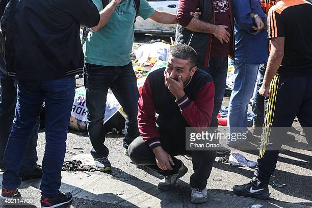 A man cries at the blast scene after an explosion during a peace march in Ankara October 10 2015 Turkey At least 30 people were killed and 130 people...