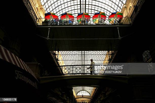 A man crosses a bridge in GUM near Red Square in central Moscow on September 30 2008 Trading of shares on both of Russia's main stock markets the RTS...
