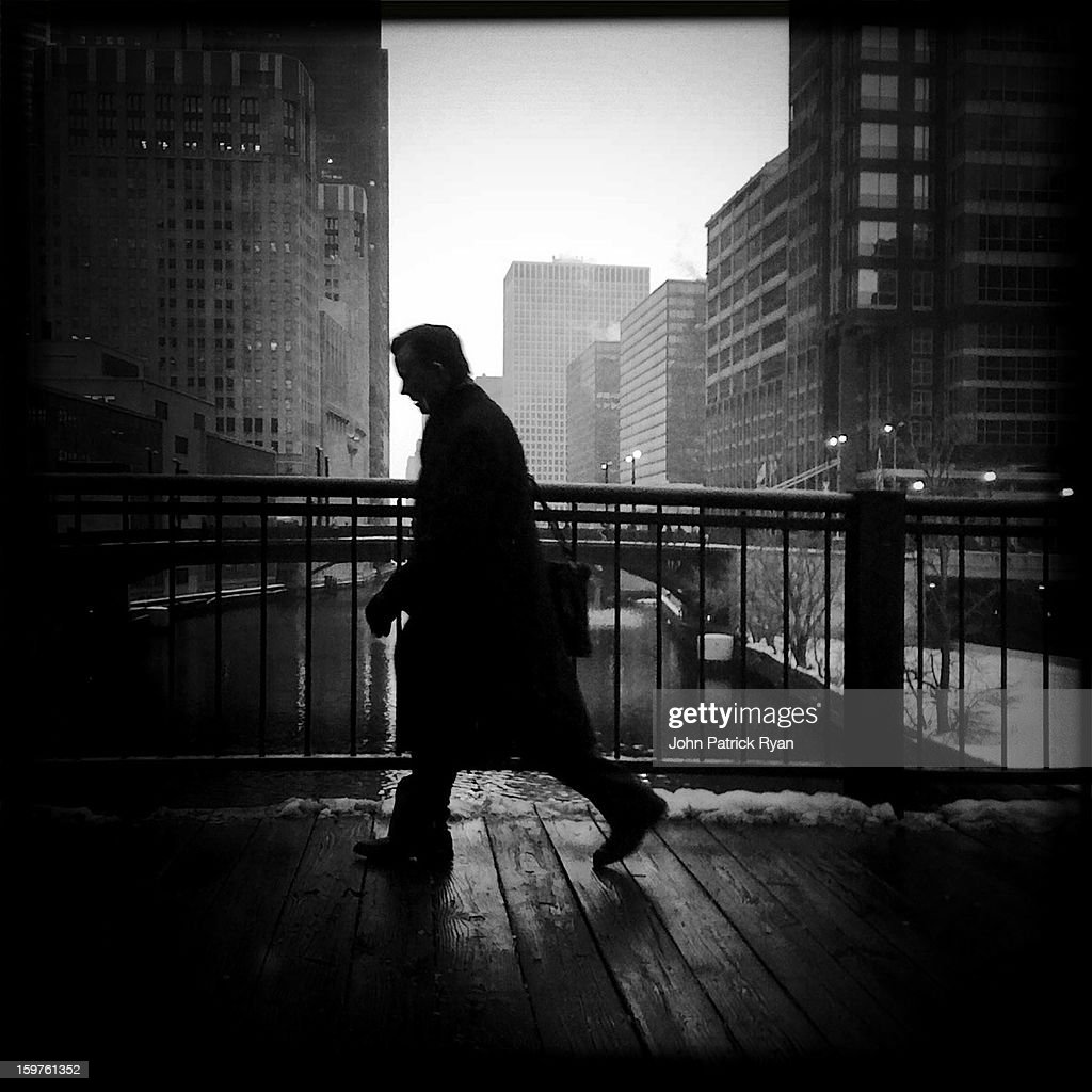 CONTENT] A man crosses the Lake Street bridge on his way to work in Chicago.