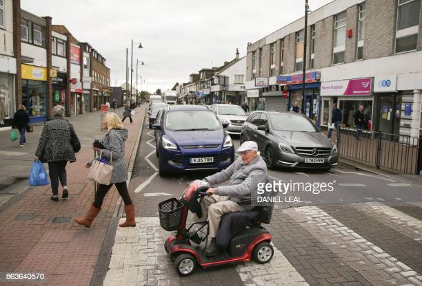 A man crosses the road on a mobility scooter on Canvey Island Essex on October 20 2017 A small island community in the Thames Estuary that voted...
