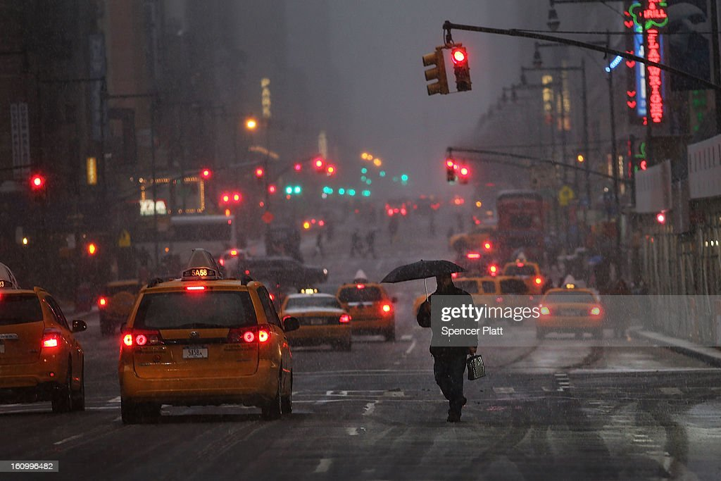 A man crosses the street in wind, snow and sleet as Manhattan experiences a major winter storm on February 8, 2013 in New York City. New York City along with much of the Northeast is expected to get a foot or more of snow through Saturday afternoon with possible record-setting blizzard conditions expected. Heavy snow warnings are in effect from New Jersey through southern Maine.