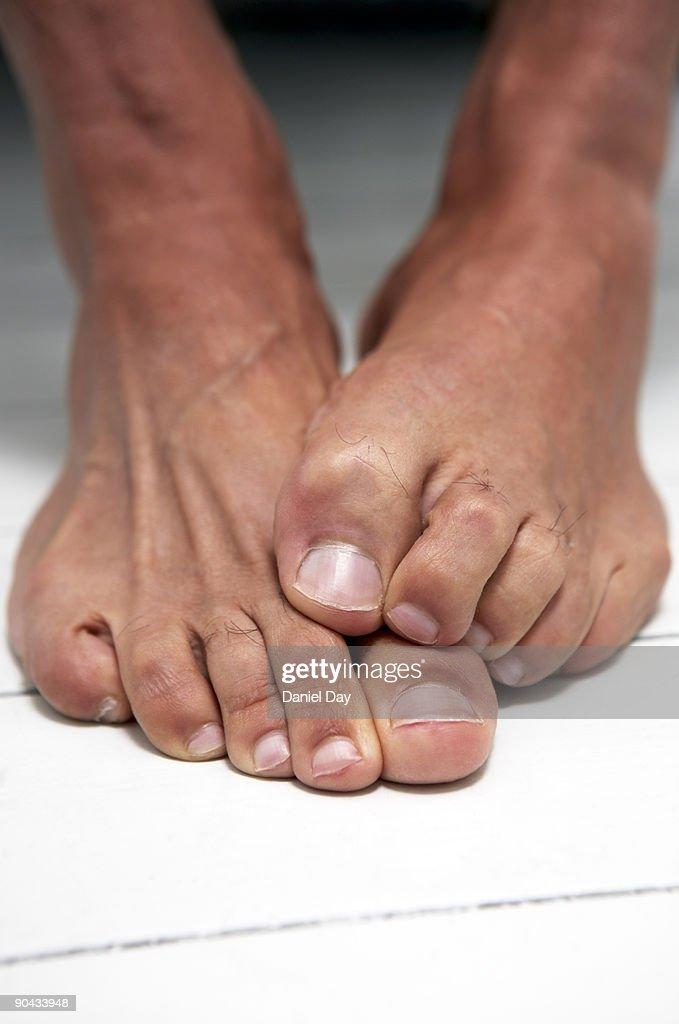 Man crossing feet : Stock Photo