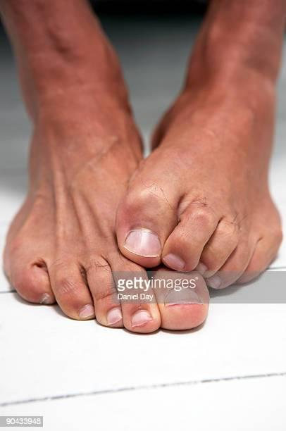 Man crossing feet