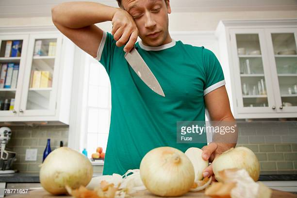 Man Crying While Chopping Onions