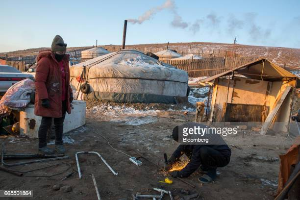 A man cuts a piece of metal in a ger district in Ulaanbaatar Mongolia on Tuesday March 14 2017 The subzero winters in Ulaanbaatar force residents...