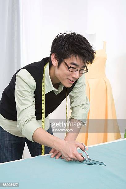 Man cutting fabric