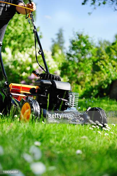 Man cutting grass / mowing the lawn